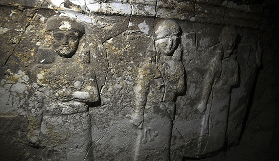 Archeological findings are pictured inside an underground tunnel in east Mosul on March 6, 2017.  Two winged bulls dating from the Assyrians empire were found in a labyrinth of narrow underground tunnels dug by the Islamic State group in east Mosul. The impressive maze of tunnels dug by the jihadists to carry out archaeological excavations is located in the heart of the hill that houses the tomb of the Prophet Jonah (Nabi Younes). / AFP PHOTO / ARIS MESSINIS        (Photo credit should read ARIS MESSINIS/AFP/Getty Images)