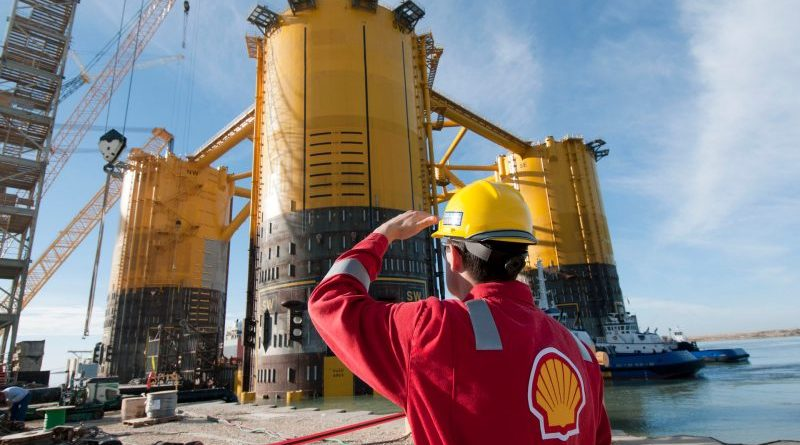 engineer-in-red-uniform-with-yellow-hard-hat-by-marsb-platform-construction